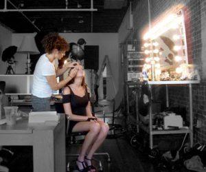 Beautiful model at makeup bench