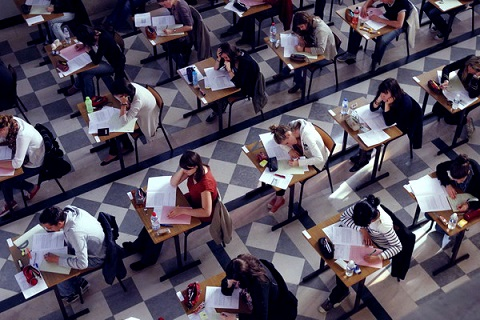 students taking test in exam hall